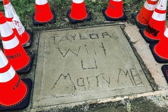 Michael Carroccia proposed to Taylor Miller with a message in the sidewalk at the home they are building on Maple Avenue in North Plainfield