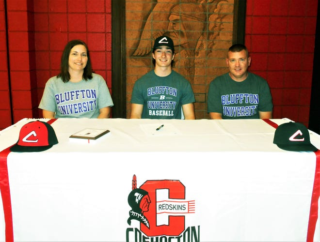 Coshocton High School graduate Garrett Rice (middle) signed to play baseball for Bluffton. His parents, Jeanette (left) and Joe (right) are also pictured.