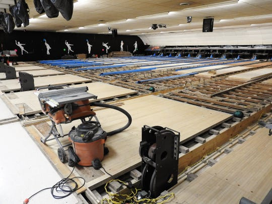 New synthetic lanes replacing wooden ones and underfloor ball returns replacing above ground ones are underway at Legacy Lanes bowling alley. The original 14 lanes have not been updated since construction in 1947.