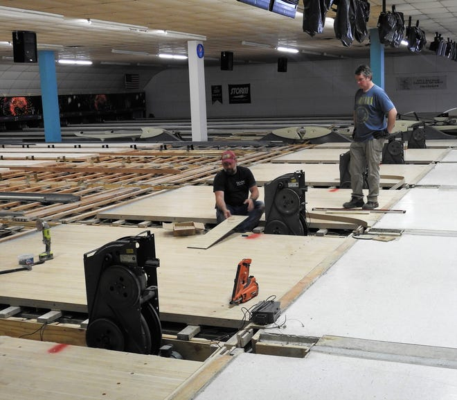 Tim Maclean and Brian Sashko of Ten-Pin Construction work on lanes at Legacy Lanes. Work is set to be completed and the bowling alley reopened around the the middle of June. Renovations were being planned prior to the COVID-19 pandemic closure. Lanes will be synthetic and ball returns will be under the floor.