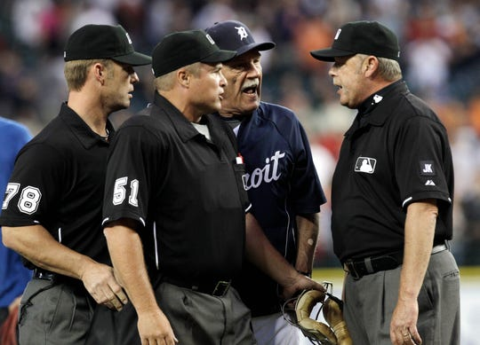 Detroit Tigers manager Jim Leyland yells at first base umpire Jim Joyce, right, as umpires Jim Wolf (78), left, and home plate umpire Marvin Hudson (51), intervene after the Cleveland Indians lost 3-0 in Detroit on June 2, 2010. Tigers pitcher Armando Galarraga lost his bid for a perfect game with two outs in the ninth inning on the disputed call at first base.