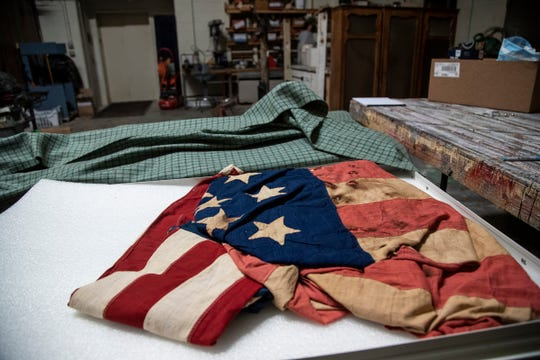 An American flag with bullet holes from the Civil War era along with other artifacts and records are being temporarily stored at the Midland Center for the Arts in Midland on May 28, 2020.