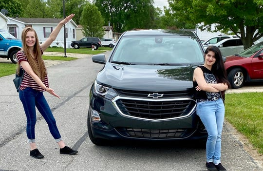 Kayla Ode (left) of the Brian Carroll Automotive Group delivered a 2020 Chevrolet Equinox on May 27, 2020 to Sheena Leaman, a machine operator from Clinton Township.