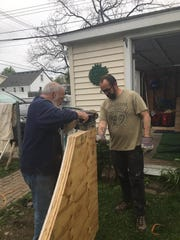 Whitney Lemelin, right, got help on the backyard skate ramp from his  82-year-old father Joseph, left.