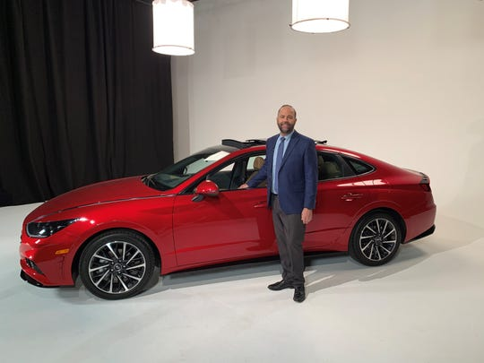 Karl Brauer, executive editor of Kelley Blue Book, is standing beside a 2020 Hyundai Sonata at a broadcast studio on November 26th, 2019 in Los Angeles.