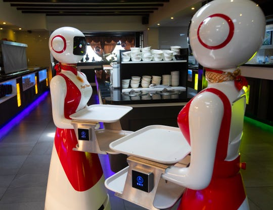Robots at the Hu family's Royal Palace restaurant in Renesse.