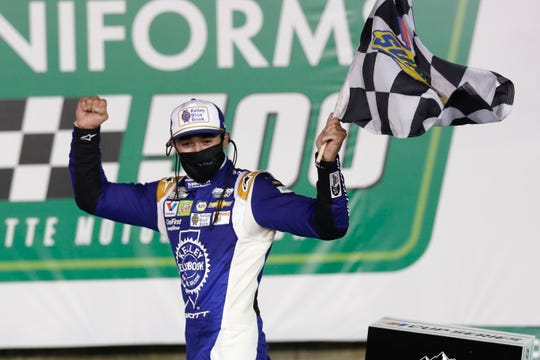 Chase Elliott celebrates after winning a NASCAR Cup Series race at Charlotte Motor Speedway Thursday night.