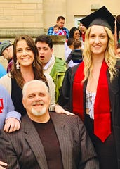 Jeff Phipps and older daughter, Brittany (left), celebrate younger daughter Sierra's graduation from IU in 2019.