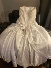 Heather Wilson's wedding dress - it's free for the taking.