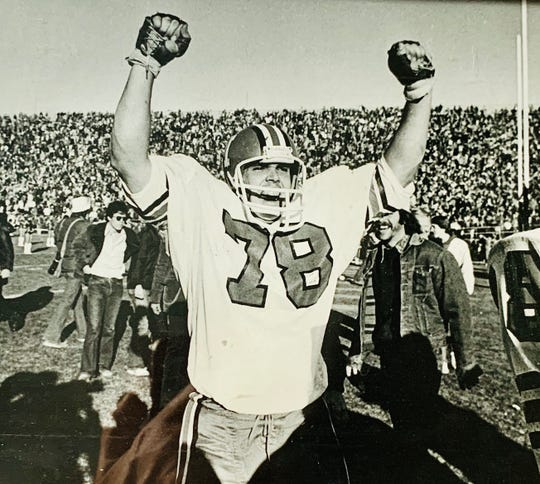 Central grad Jeff Phipps celebrates after IU's victory over Purdue in his freshman year. He switched to No. 66 the rest of his career with the Hoosiers.