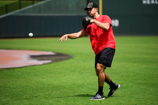 Texas Rangers center fielder Eli White throws the ball during practice at Fluor Field Friday, May 28, 2020.