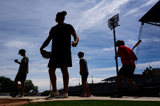 Major league and minor league baseball players practice at Fluor Field Friday, May 28, 2020.