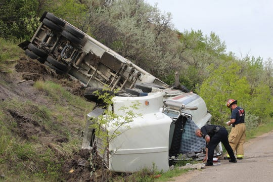 The truck driver sustained head injuries, but was conscious and speaking when emergency responders arrived