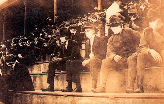This undated photo shows a Georgia Tech home game during the 1918 college football season, with fans wearing masks in the stands as the Spanish flu pandemic struck the United States in two waves.