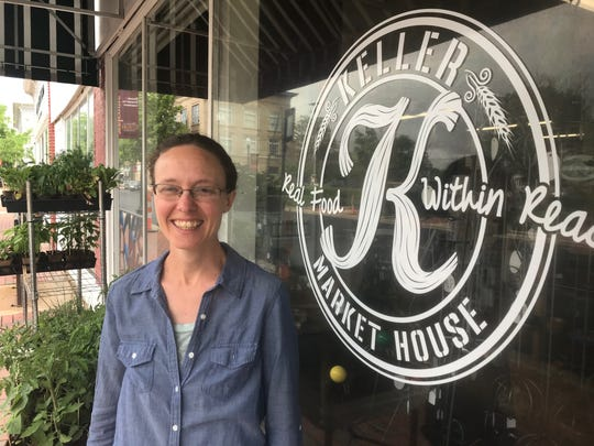 Keller Market House manager Erin Harvey stands beside the store at 134 S. Columbus St. She also supervises the nearby Lancaster Farmers Market on Saturday mornings.