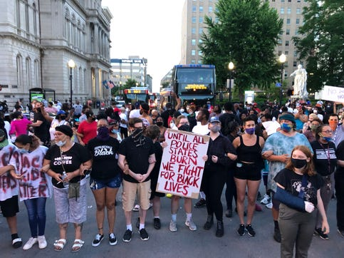 Protesters gather in downtown Louisville late in the evening of May 28 to call for justice in the case of Breonna Taylor, who was fatally shot by LMPD officers in her apartment.