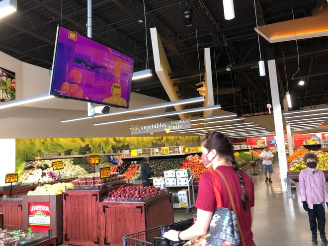 A thermal graphic camera shows and takes the temperature of customers at the Cermak grocery story on Barclay Street. Both Milwaukee Cermak stores have installed the camera and more businesses may take similar action.