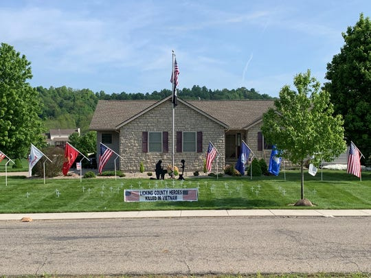 Every Memorial Day and Veterans Day, Navy veteran Paul Chapman displays flags representing every branch of military service, and crosses for the 48 from Licking County who died in the Vietnam War, in his yard near Licking Valley High School.