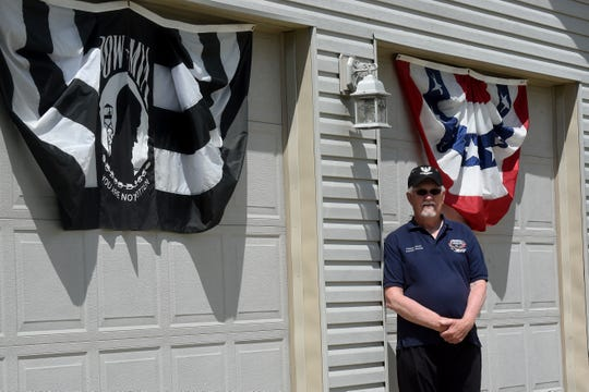 Retired Navy veteran Paul Chapman shows support for fellow veterans on Memorial Day and Veterans Day by putting out a display of flags and crosses in his yard.