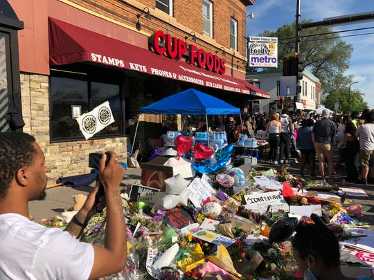 Hundreds gather at a vigil held Thursday, May 28, 2020, in front of the store where George Floyd, 46, died in the custody of police at the intersection of 38th Street and Chicago Avenue in Minneapolis, Minnesota.
