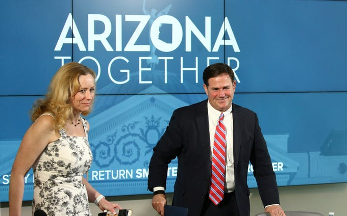 Arizona Gov. Doug Ducey Dr. Cara Christ, Director of Arizona Department of Health Services, left, depart after speaking about the state's most recent coronavirus data during a news conference Thursday, May 28, 2020, in Phoenix.