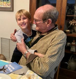 Thomas Yates, who's 9, with his grandfather, Ron Yates, in Tempe in times before the pandemic.