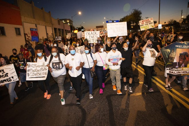 Protesters march down Van Buren Street in downtown Phoenix to show solidarity and support for the family of George Floyd, who recently died while being held by Minneapolis police officers.
