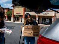 Cindy Louie, founder of Hawker Street Market, puts a box of Rewind ice cream to be donated to different Mesa shelters in her car on May 14, 2020.