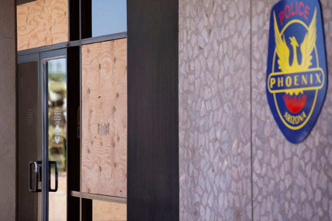 Boarded-up windows are seen at the entrance of Phoenix police headquarters on May 29, 2020, in Phoenix.