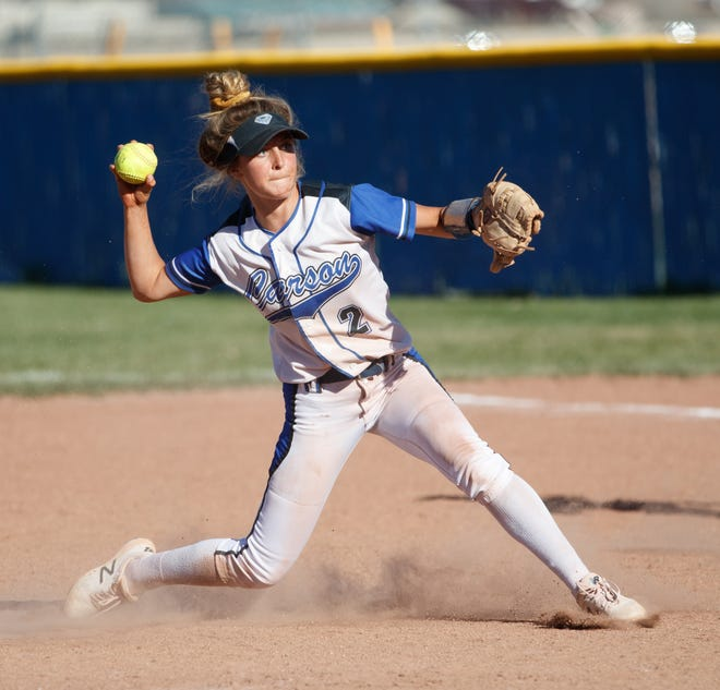 Carson's Kailee Luschar throws to first during the NIAA Northern 4A Region softball game between the Carson Senators and the Spanish Springs Cougars at Carson  last year.