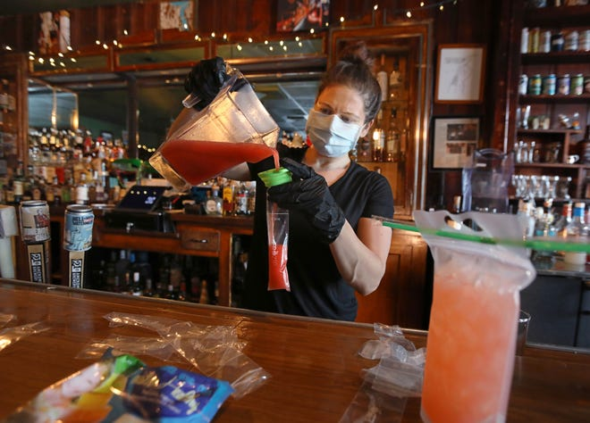 Aimee Rock makes a batch of strawberry daiquiri boozy freeze pops at the Union Tavern in Irondequoit. They hold four ounces of liquid, including one ounce of alcohol.