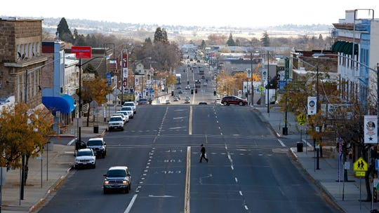 In this Nov. 16, 2016, photo, drivers and pedestrians use Main Street in Susanville in Lassen County. The first California county to backpedal on its reopening plan has reversed itself again and decided to allow dining in restaurants and shopping in stores after determining it successfully mitigated its first small outbreak of coronavirus cases.