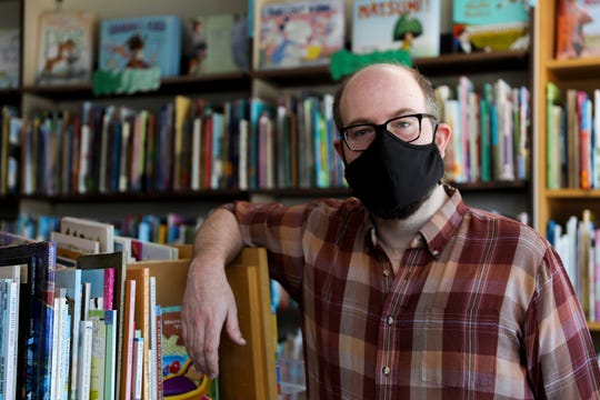 The Book Bin co-owner Obadiah Baird poses for a photo at The Book Bin in Salem, Oregon, on May 29, 2020. Masks are required at the book store.