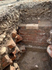A basement brick wall uncovered during excavation at the Jason Lee archaeological site on Broadway Street NE in Salem.