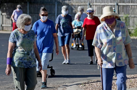 Members of the Immanuel Baptist Church Senior Ladies Sunday School group participate in a prayer walk in the Northgate Estates neighborhood in San Angelo on Thursday, May 28, 2020.
