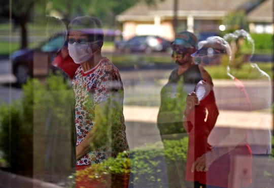 Members of the Immanuel Baptist Church Senior Ladies Sunday School group participate in a prayer walk at the Baptist Retirement Community in San Angelo on Thursday, May 28, 2020.