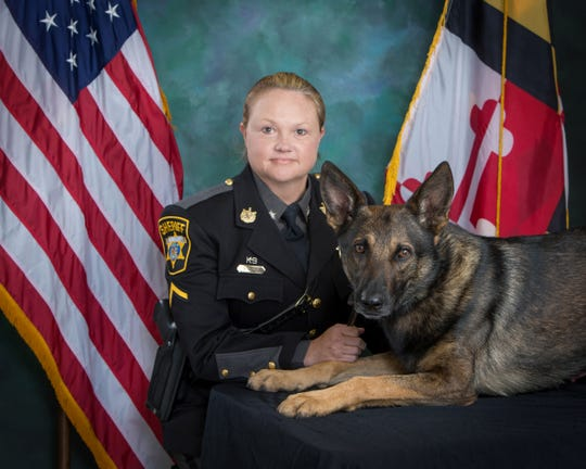 Wicomico County Sheriff's Deputy First Class Bobbi Jo Lewis poses with her K-9 Rookie who will retire after six years with the department.