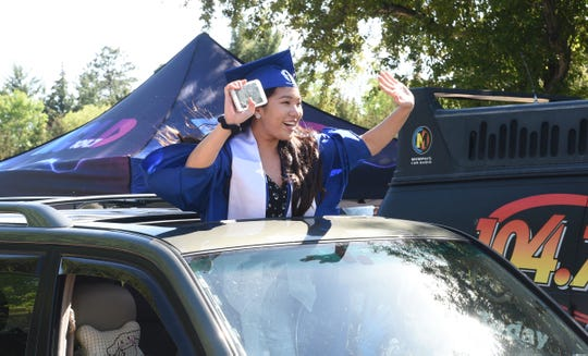 Apollo students picked up their diplomas and said goodbye to staff in a celebratory vehicle parade Friday, May 29, 2020, at Apollo High School.