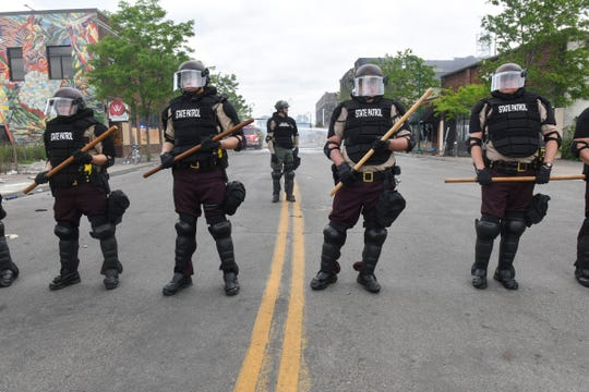 State Patrol officers form a line to block a street near the former location of the Minneapolis Police DepartmentÕs Third Precinct building Friday, May 29, 2020, in Minneapolis, Minn.