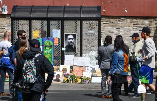 Memorials to George Floyd are placed near the Cup Foods store Friday, May 29, 2020, at the corner of Chicago Avenue and East 38th Street in Minneapolis, Minn.