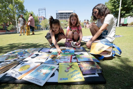 Plenty of books were on hand for kids to read during a peaceful protest of closed parks and libraries May 29 at Cleveland Square Park.