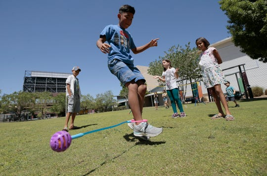 Ryan Jernegan, 11, plays at Cleveland Square Park as members of Reopen Texas and Free to Play have a rally on May 29 urging the city of El Paso to reopen parks and libraries.
