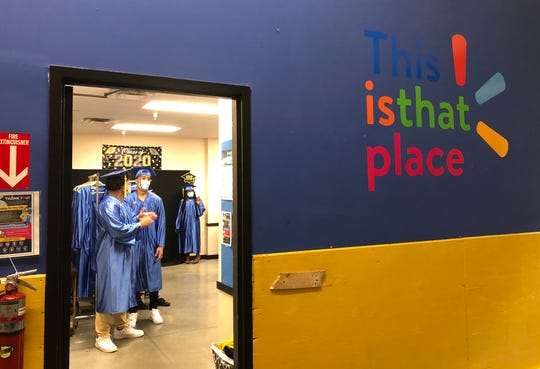 Darwin Francisco of Vineland High School prepares to lead his co-workers in a commencement procession at the Vineland Walmart. The store honored associates earning high school diplomas or college degrees during the pandemic. May 29, 2020.