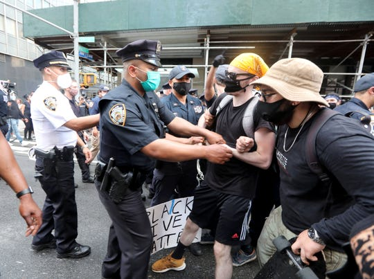 A protestors is arrested in front of the Manhattan Detention Center in lower Manhattan May 29, 2020 as thousands took the streets of the city to protest the death of George Floyd in Minneapolis earlier this week.