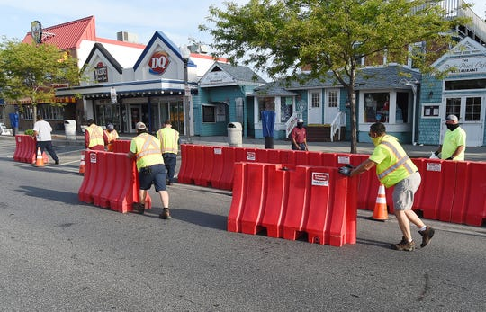 City of Rehoboth Beach crews place barricades on Rehoboth Avenue Friday closing off parking for the first two blocks to allow businesses to use the sidewalks for outdoor dining and shopping starting on June 1. The outdoor spaces are part of the first phase of shops and restaurants reopening from the COVID-19 shutdown.