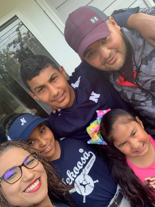 """Francisco """"Paco"""" Vega, right, died from COVID-19 on May 22. He is shown with his wife, Maricruz, from left, daughter Emily, son Francisco """"Paquin"""" and daughter Amairani."""