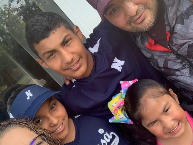 "Francisco ""Paco"" Vega, right, died from COVID-19 on May 22. He is shown with his wife, Maricruz, from left, daughter Emily, son Francisco ""Paquin"" and daughter Amairani."