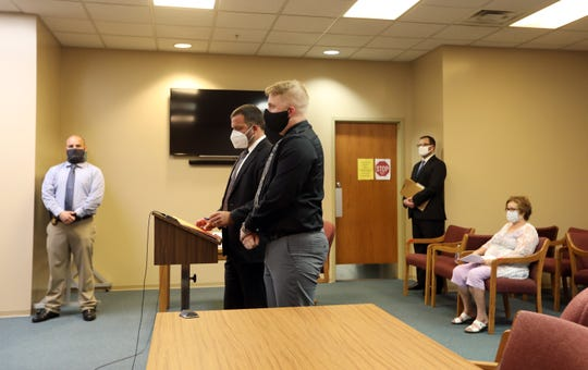 Former West Muskingum High School teacher Timothy Stover stands next to his lawyer, Chase Mallory, during his plea hearing in Muskingum County Court on Friday. Stover pleaded guilty to two counts of endangering children after sending inappropriate texts to students.
