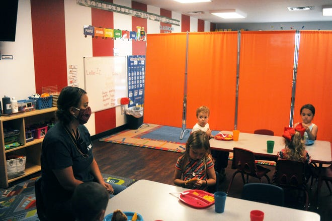 Emilea Allison watches over her class of 2 to 5-year-olds as they eat lunch on Friday at The Little Barnyard. The daycare was opened during the pandemic, as it served essential workers. Area daycares are feeling the impact of the state's new protocol, which includes additional costs with less clients.