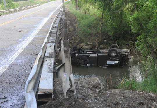 A Ford F30, driven by Mark Snode, crashed and overturned in a creek on Ohio 146 on Friday. Snode was transported to Genesis.